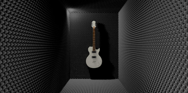 An acoustic foam cladded sound room with a white electric guitar mounted on one of the walls
